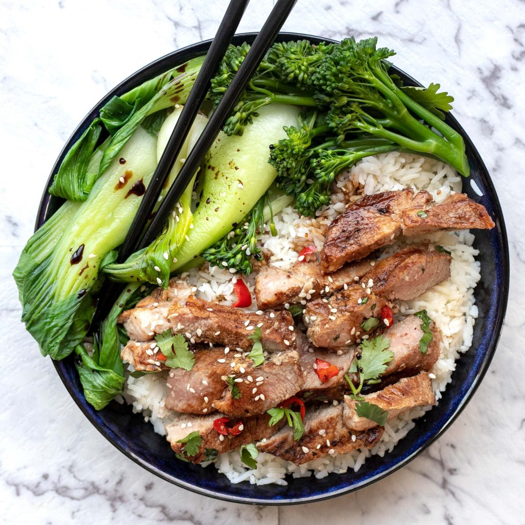 CHILLI PORK STEAKS WITH ASIAN GREENS